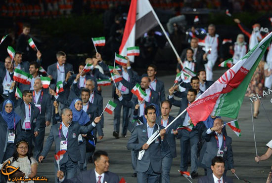 Iran's flagbearer Ali Mazaheri (C) leads his delegation during the opening ceremony of the London 2012 Olympic Games on July 27, 2012 at the Olympic Stadium in London.     AFP PHOTO / GABRIEL BOUYS        (Photo credit should read GABRIEL BOUYS/AFP/GettyImages)